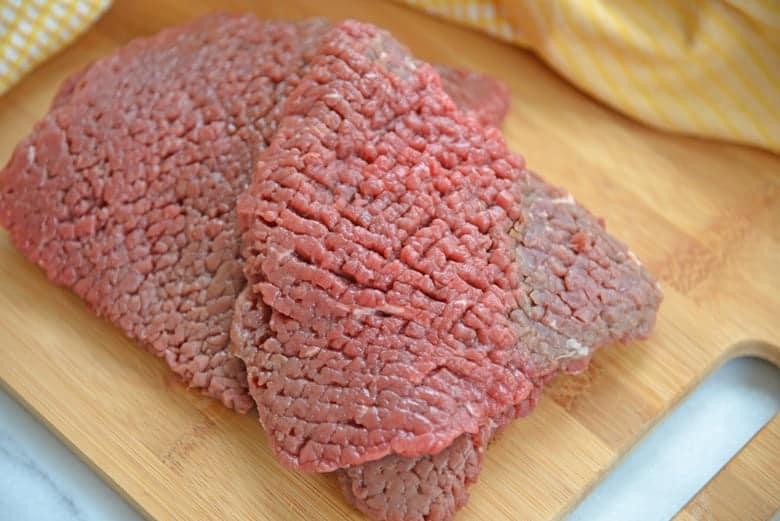 Cubed steak on a cutting board