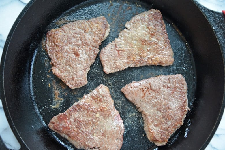 Stovetop cube steak in a cast iron skillet