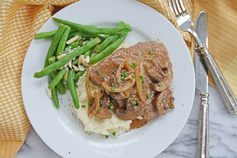 Overhead of easy cube steak with steamed green beans