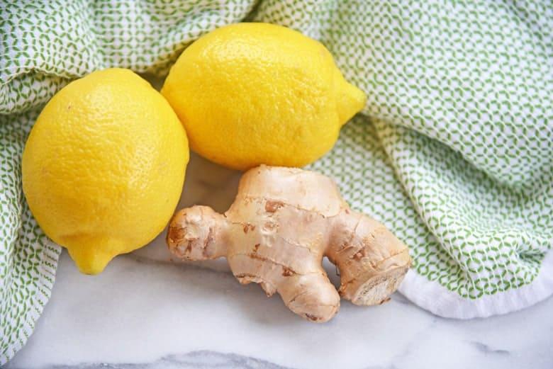 Lemons and ginger on a green linen
