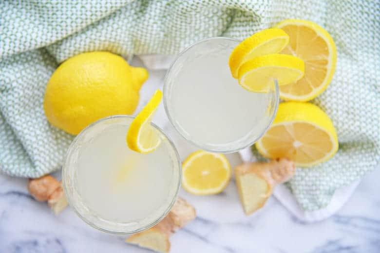 Overhead of ginger lemon water on marble