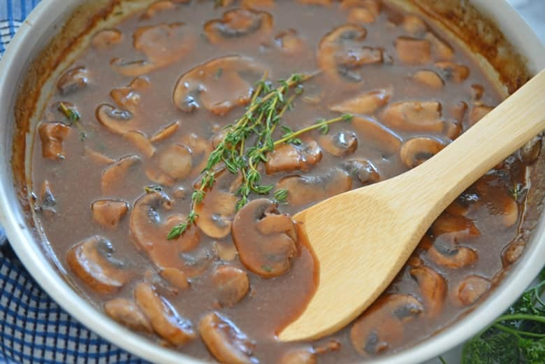 Sliced mushrooms in a rich savory sauce with fresh thyme
