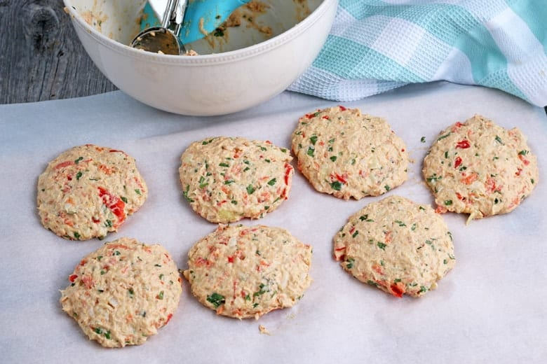 Uncooked salmon patties on parchment paper