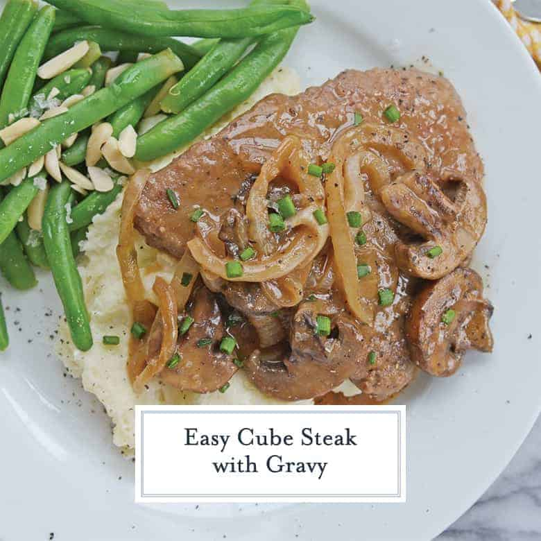 Easy Cube Steak recipe on a white plate with onion mushroom gravy
