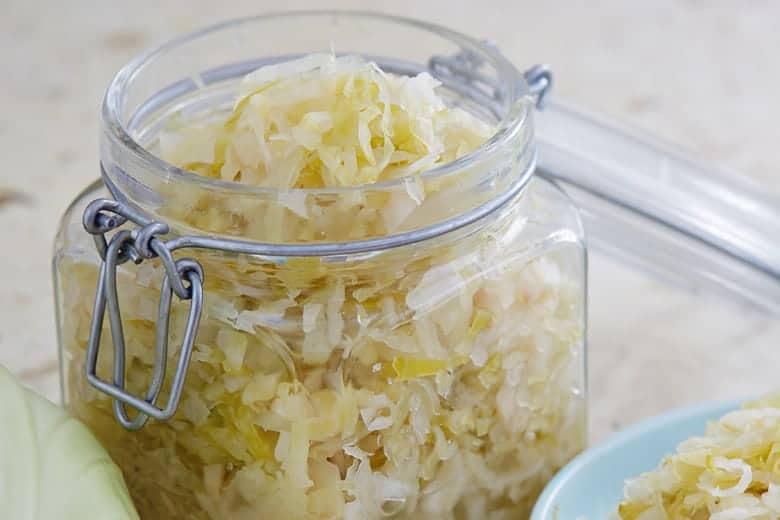 Homemade sauerkraut in a decorative glass jar
