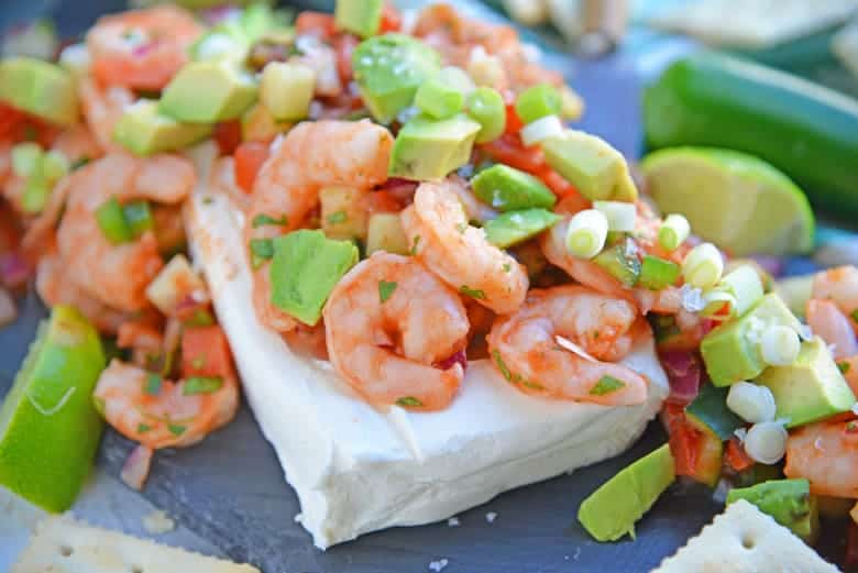 Large shrimp over cream cheese with Mexican flavors