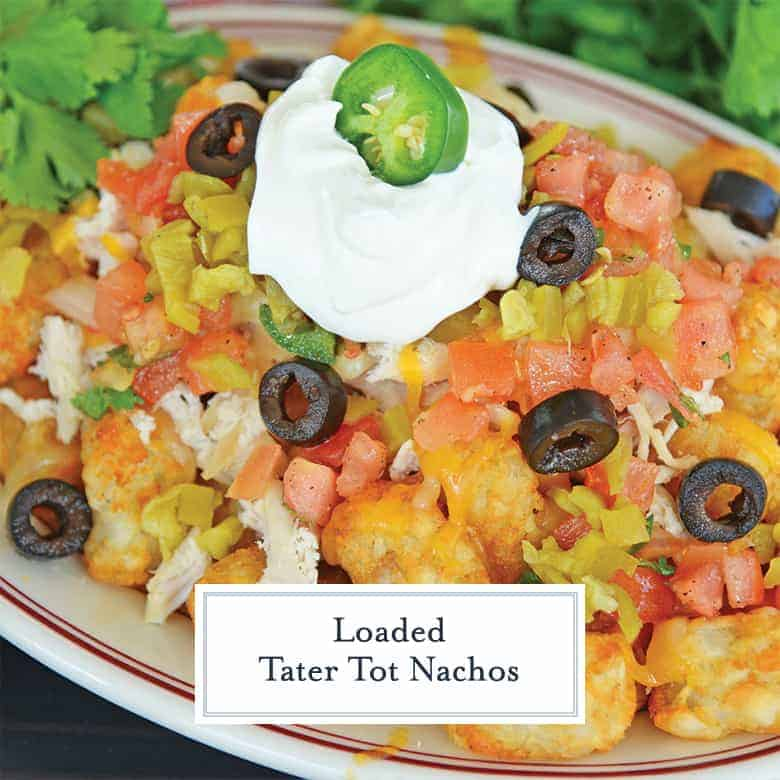 Close up of totcho recipe with sour cream, black olives, green chiles, chicken and pico