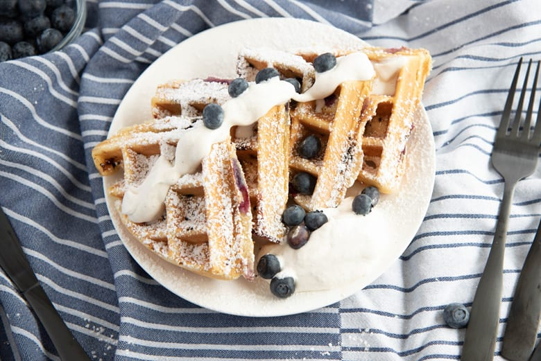 Sliced blueberry waffles on a plate