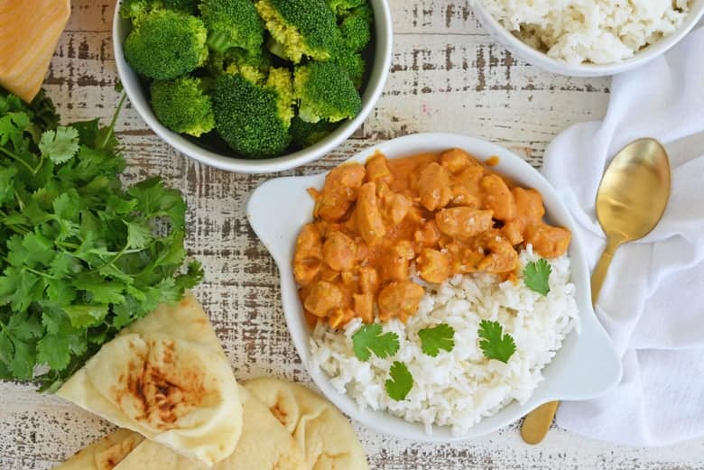 Overhead image of butter chicken with broccoli