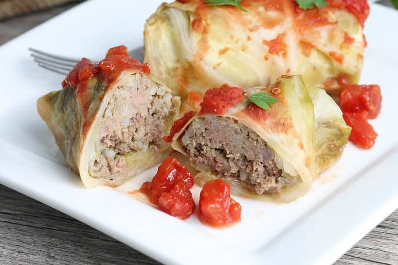 Cabbage roll cut in half with ground beef and rice filling