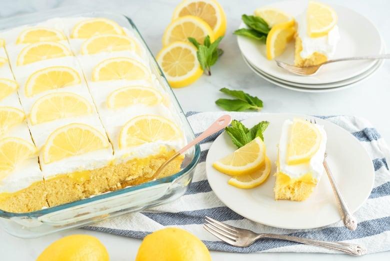 Serving lemon poke cake with mint leaves