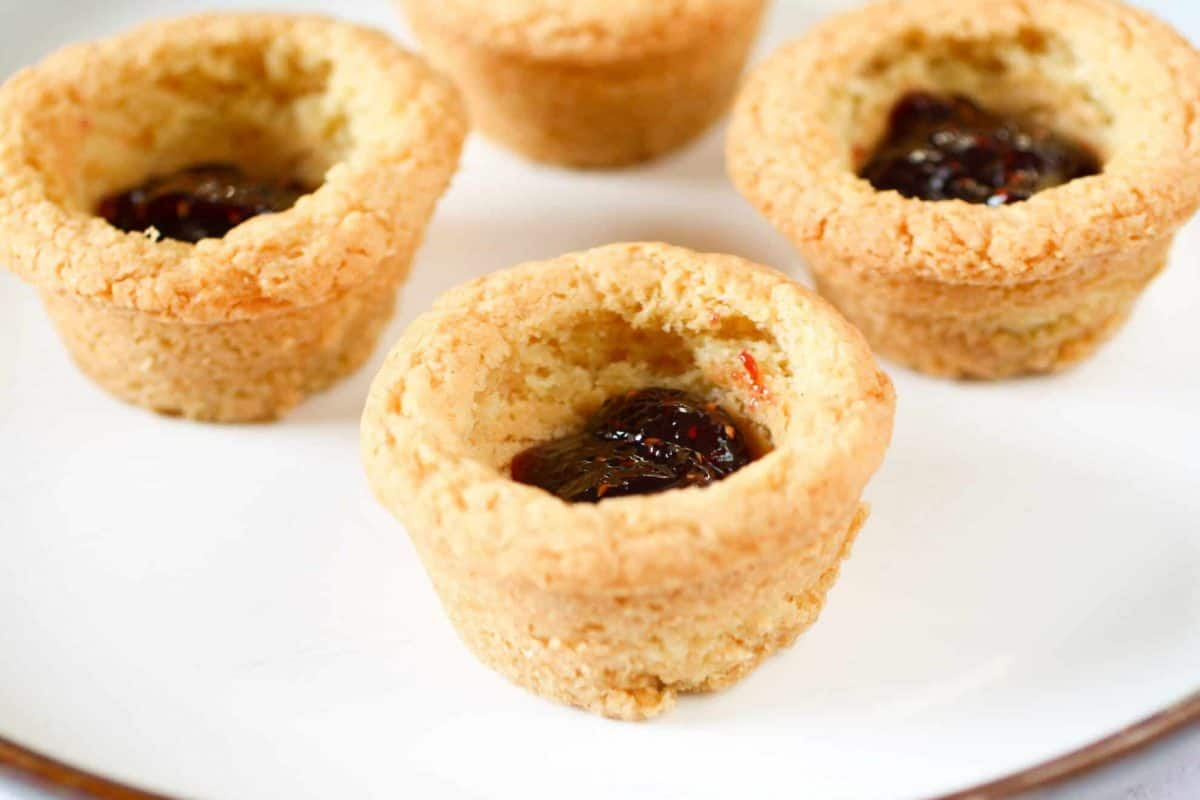 Sugar Cookie Cups filled with raspberry jam