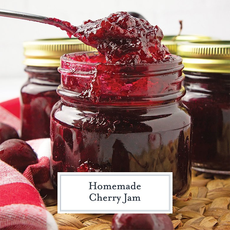 Homemade Cherry Jam being spooned out of a mason jar
