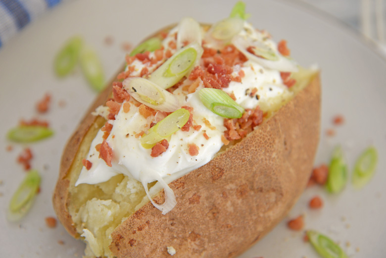 close up of dressed baked potato