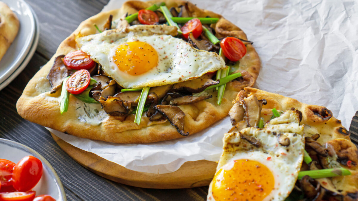 Vegetable breakfast pizza being served