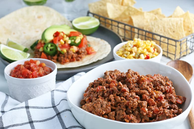 taco meat with taco toppings ready to be served