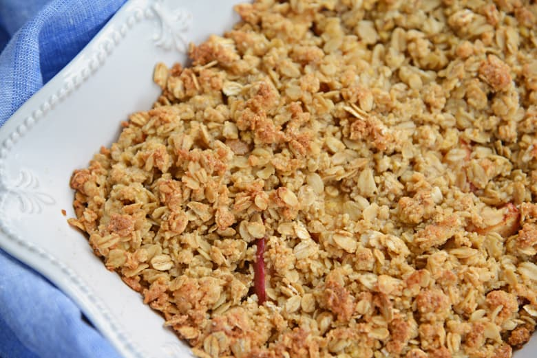 corner of an apple crisp in the baking dish
