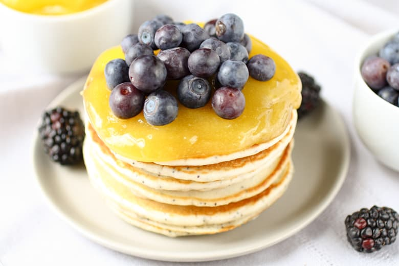 stack of pancakes with lemon curd and blueberries