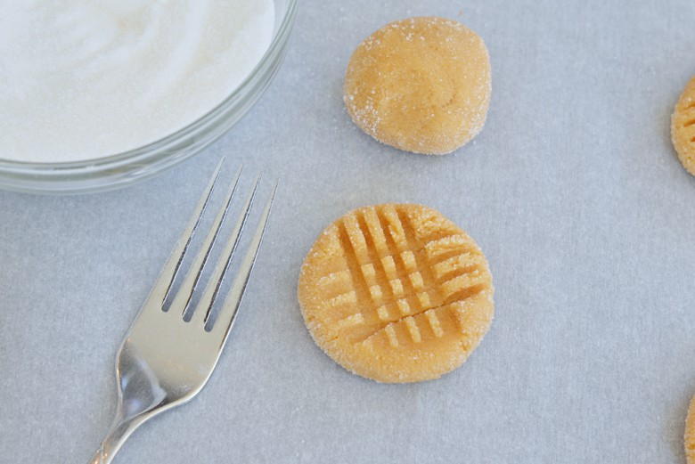 peanut butter cookie being crosshatched with a fork