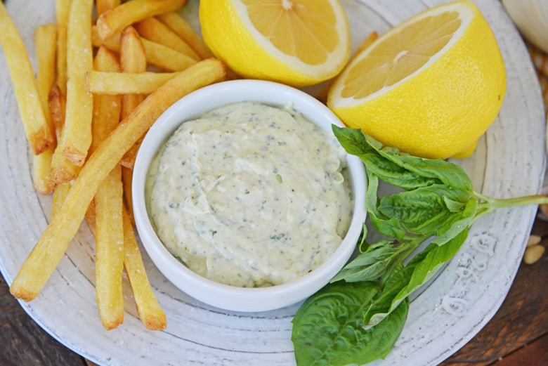basil aioli served with french fries and  fresh basil and lemon