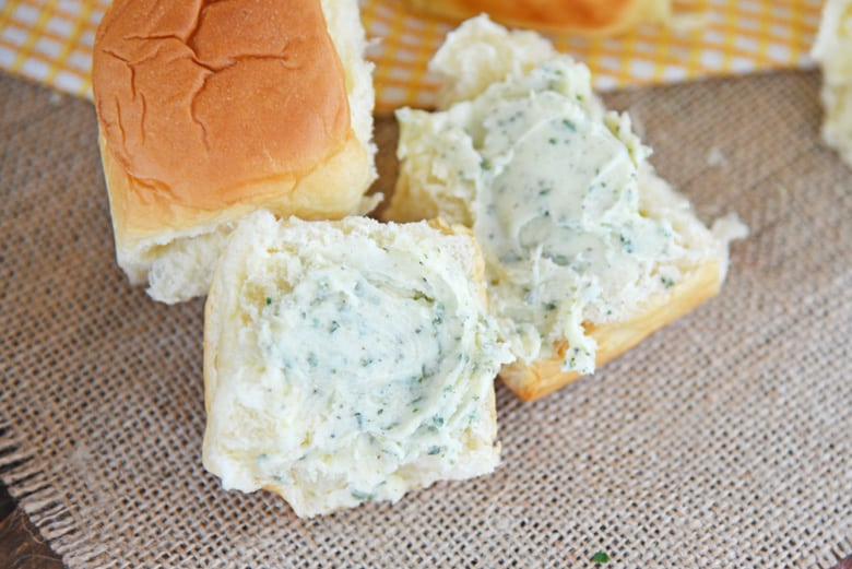 A close up of roll with butter