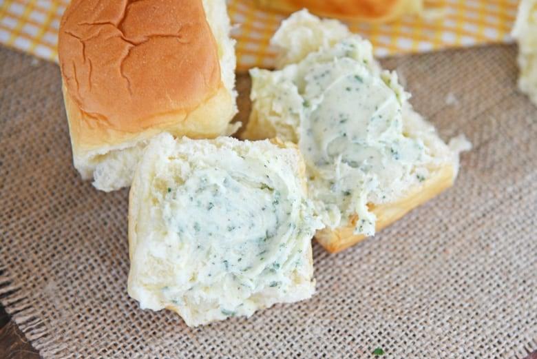 Buttered dinner roll on burlap