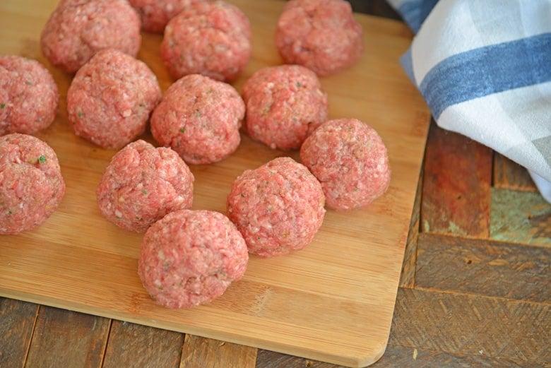 raw ranch meatballs on a wood cutting board