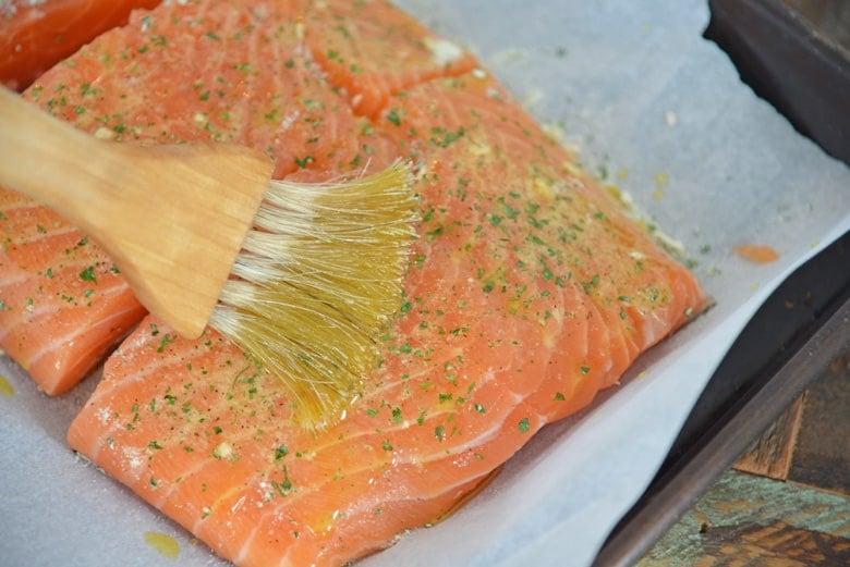 Basting salmon filet with ranch seasoning