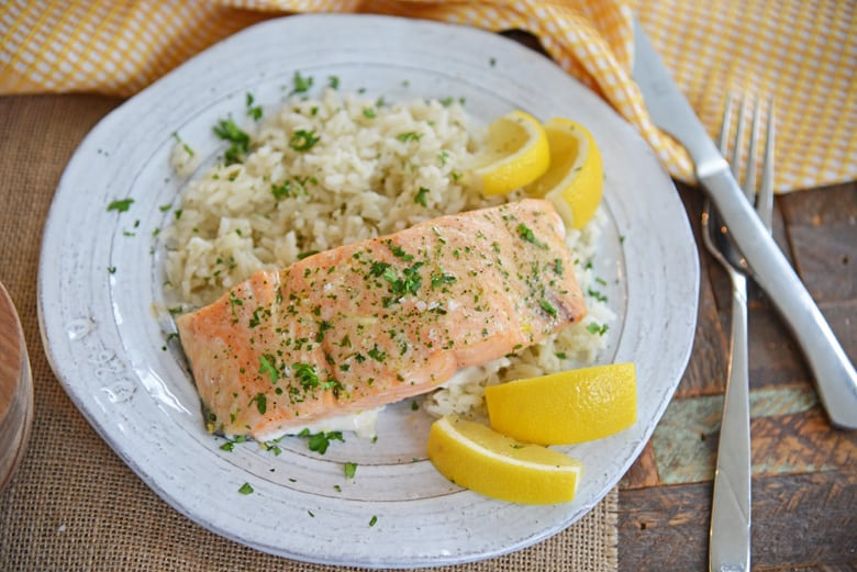 Ranch salmon with rice and fresh lemon wedges