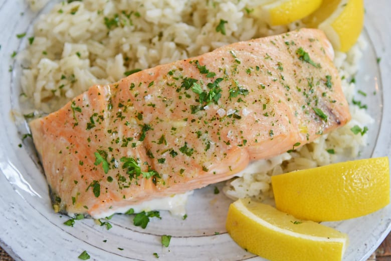 A plate of salmon with rice