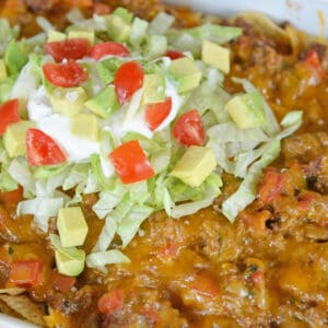 close up of taco bake with cheese and lettuce