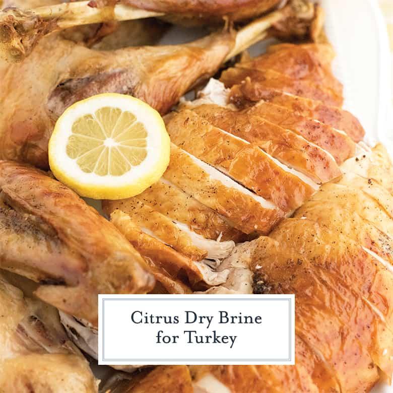 Lemon dry brine for turkey, turkey is sliced with a lemon slice