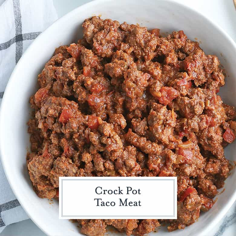 crockpot taco meat in a white serving bowl with salsa