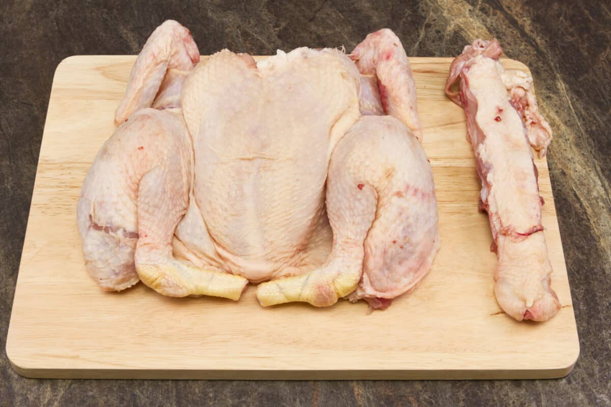 spatchcocked chicken on a cutting board