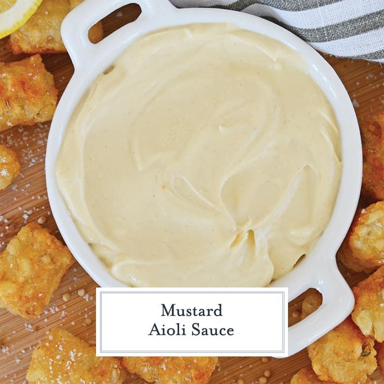 overhead of creamy mustard aioli sauce with tater tots