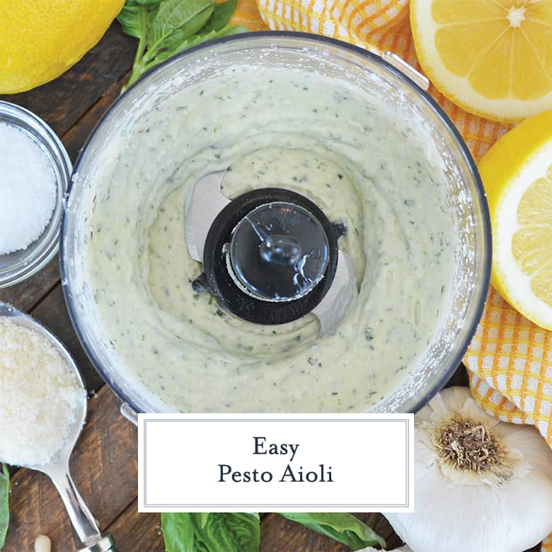 Pesto mayo in a food processor surrounded by ingredients
