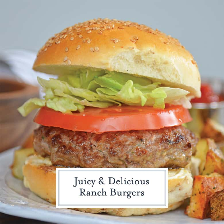 juicy ranch burger with iceberg lettuce, slice of tomato and sesame seed bun