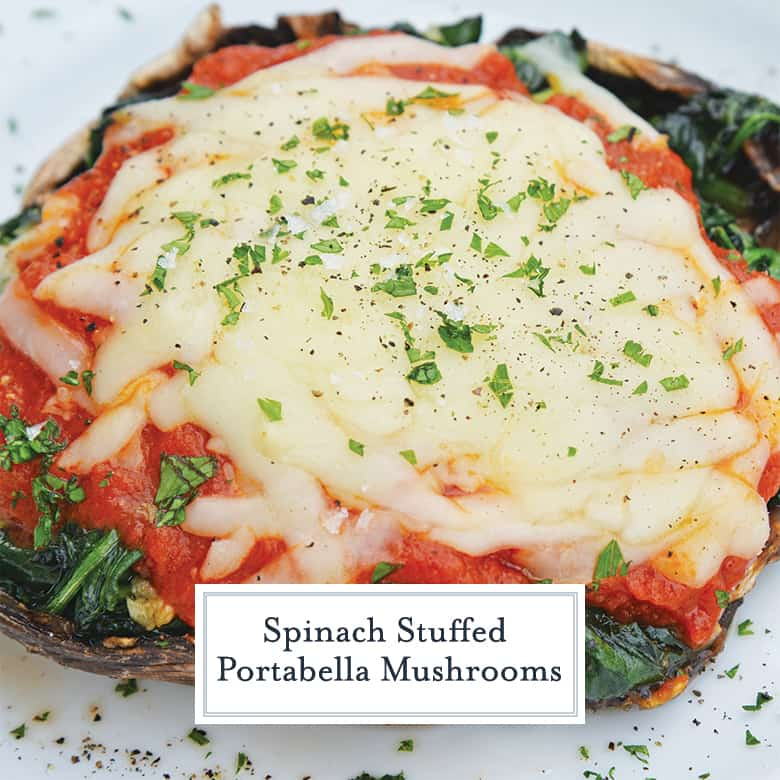 Close up of spinach stuffed mushrooms with tomato sauce and cheese