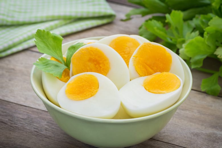 bowl of halved air fryer hard boiled eggs