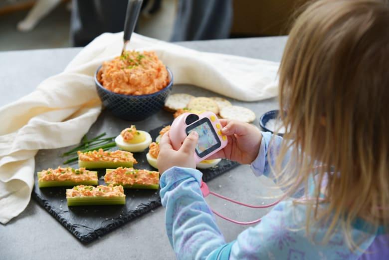 toddler taking food pics