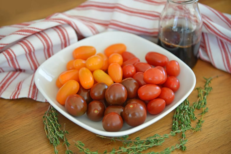 ingredients for balsamic stewed tomatoes - grape tomatoes, balsamic vinegar, fresh thyme
