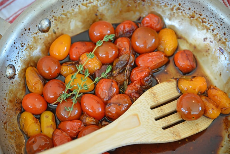 tomatoes cooking in a skillet
