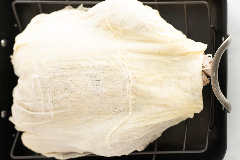 turkey covered in a butter soaked cheesecloth