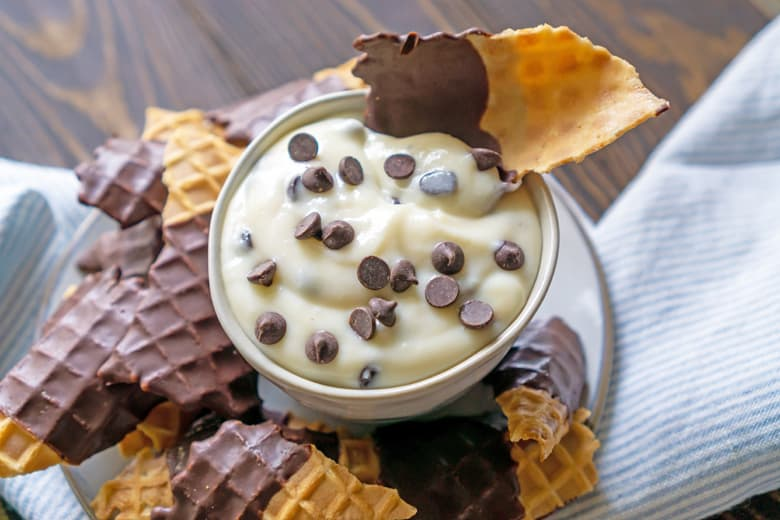 close up of cannoli dip with chocolate chips