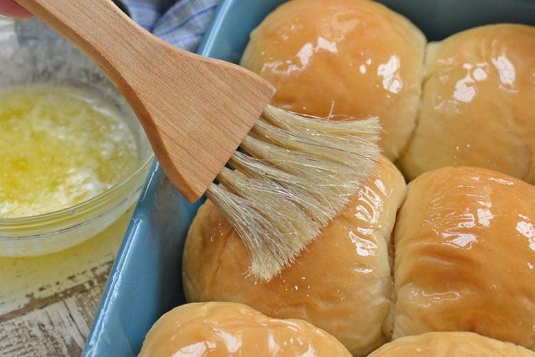 butter basting on homemade dinner rolls