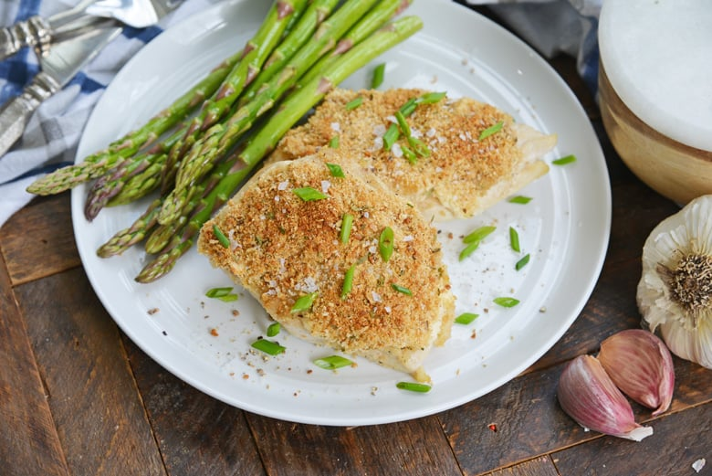 Hellman's mayo chicken on a white plate with asparagus