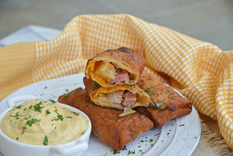 german egg rolls cut in half with dipping sauce