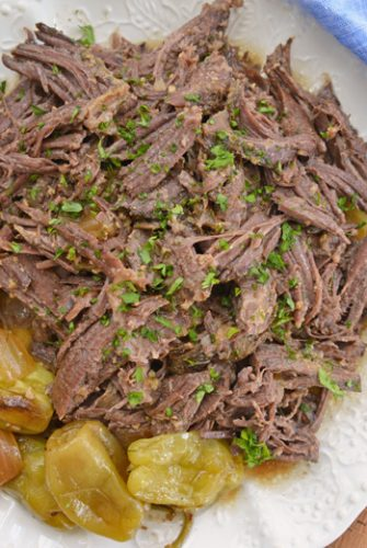 mississippi pot roast on a white serving platter