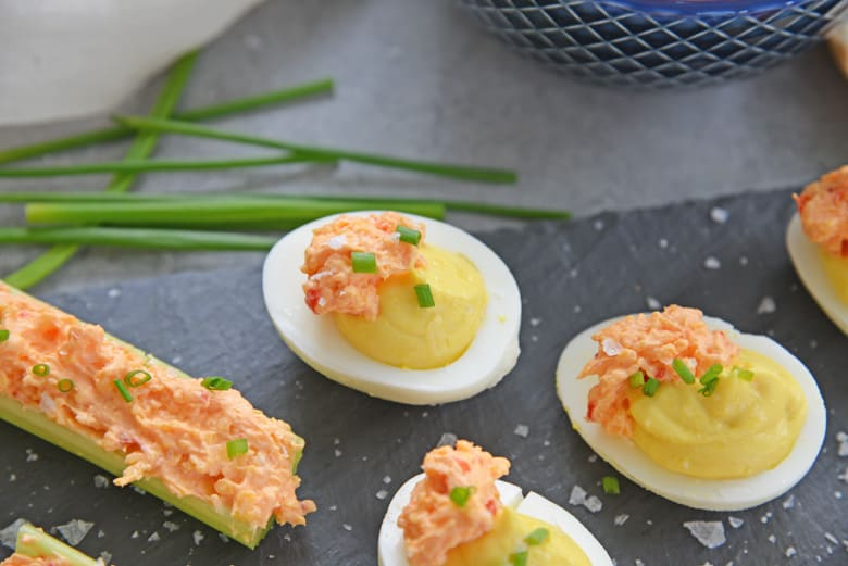 pimento cheese hard boiled egg on slate serving tray