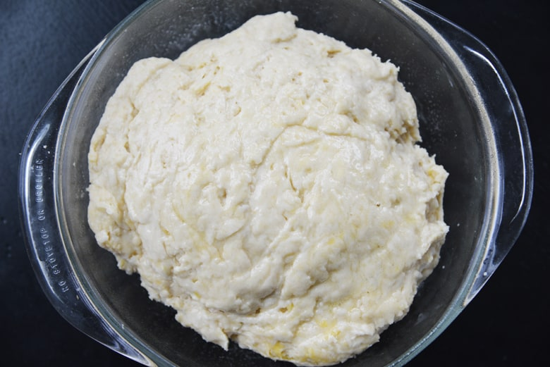 bread dough in a round baking dish